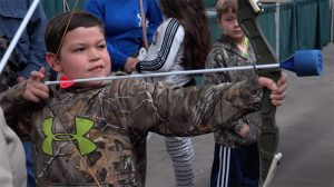 Kid Shooting Bow